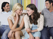 Friends Relaxing on Sofa — Stock Photo