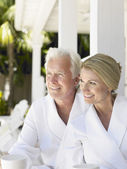 Couple sitting on verandah — Stock Photo