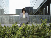 Businesswoman sitting outside — Stock Photo