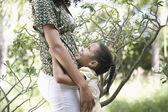 Girl  hugging mother — Stock Photo