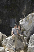 Couple Relaxing in Rocky Landscape — Stock Photo