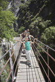 Family Walking on Footbridge — Stock Photo