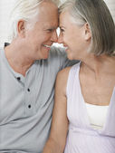 Couple sitting face to face — Stock Photo