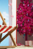 Christmas tree in beach cabin — Stock Photo