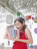 Girl  opening birthday present — Foto Stock