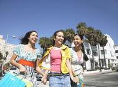 Girls carrying shopping bags — Stock Photo