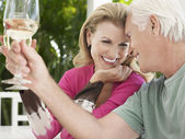 Couple holding wine glasses — Stock Photo