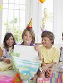 Boy open birthday presents — Stock Photo