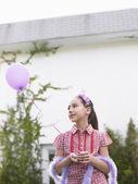 Girl  holding balloon — Stock Photo