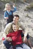 Parents with daughter  on beach — Stock Photo