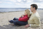 Couple sitting on beach — Stock Photo