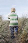 Boy walking on path — Stock Photo