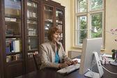 Professor Using Computer — Stock Photo