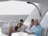 Couples relaxing on yacht — Stock Photo
