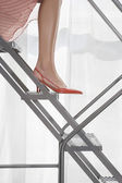 Woman wearing high heeled shoes — Stock Photo