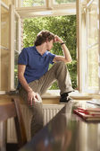 Student Sitting on Study Windowsill — Stock Photo