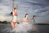 Girls  splashing in sea — 图库照片