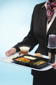 Stewardess holding tray  with food — Stock Photo