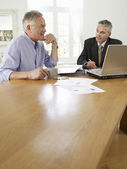 Man planning personal finance with finacial advisor — Stock Photo