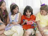 Children sitting on sofa — 图库照片