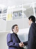Business men shaking hands — Stock Photo