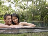 Couple smiling in Swimming Pool — Foto Stock