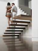 Couple Descending Stairs — Stock Photo