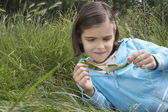 Girl Examining Caterpillar — Foto Stock