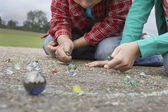 Boy and Girl Playing Marbles — Stock Photo