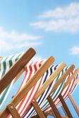 Deck chairs on beach — Stock Photo