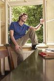 Student Sitting on Study Windowsill — Stock Photo