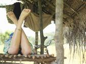 Woman lying in hut — ストック写真