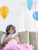 Girl preparing birthday balloons — Stock Photo