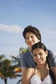 Teenage couple embracing o — Stock Photo