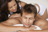 Woman massaging man — Stock Photo
