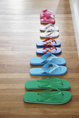 Row of flip-flops — Stock Photo