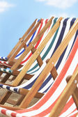 Row of deck chairs on beach — Stock Photo