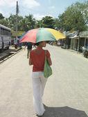 Woman on road walking — Stock Photo