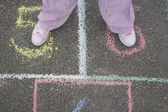 Girl Playing Hopscotch — Stock Photo