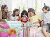 Children sitting on sofa — Stok fotoğraf