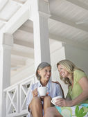 Women sitting on verandah — Stock Photo