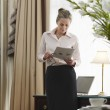 Businesswoman Reading Document — Stock Photo #33876689