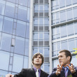 Businessmen talking outside office — Stockfoto #33878945