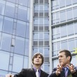 Businessmen talking outside office — Stock Photo #33878945