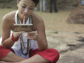 Woman reading postcard — 图库照片