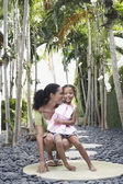 Mother crouching with daughter — Stock Photo