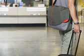 Traveller with bags at airport — ストック写真