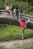 Children onTree Trunk — Stock Photo