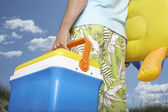 Man carrying inflatable toy — Stock Photo
