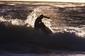 Man surfing wave silhouette — Stock Photo